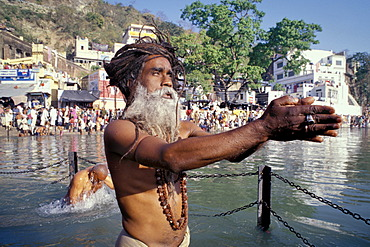 Sadhu during a Hindu morning prayer in the Ganges River, Puja, Kumbh or Kumbha Mela, Har Ki Pauri Ghat, a famous bathing ghat at Haridwar or Hardwar, Uttarakhand, formerly Uttaranchal, North India, India, Asia