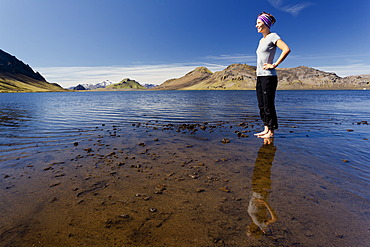 Young woman reflected in Lake Álftavatn, Laugavegur, Iceland, Europe