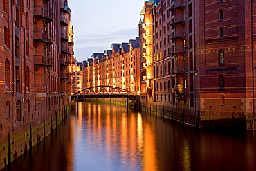 Illuminated warehouses and a channel, Speicherstadt district, Free and Hanseatic City of Hamburg, Germany, Europe