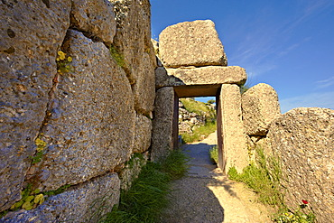 "The North Postern gate, 1250 B.C., made from four monolithic blocks of ""Almond Stone"" in the typical form of two upright jams, a lintel over the top and threshold, Mycenae UNESCO World Heritage Archaeological Site, Peloponnese, Greece, Europe"
