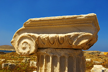 Delphic column capital of the ruins of the Greek city of Delos, Cyclades Islands, Greece, Europe