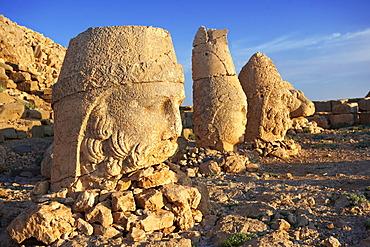 Broken statues around the tomb of Commagene King Antochius 1 on top of Mount Nemrut, Turkey