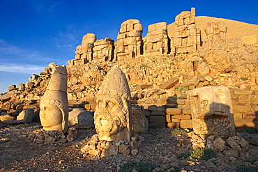 Broken statues around the tomb of Commagene King Antochius I on top of Mount Nemrut, Turkey