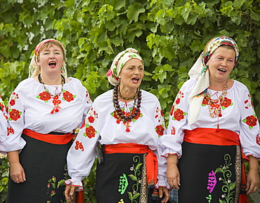 Three peasant women in traditional Ukrainian costume performing a countrified folk dance at the farmers\' museum in the formerly German inhabited Bessarabian village Friedenstal, today\'s Mirnopolje, Ukraine