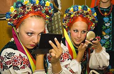 """Two members of the folklore dance troupe """"Bessarabskij Souvenir"""" putting on make-up before a performance at the Black Sea resort of Sergejewka, also known as Serhijivka, Ukraine, Eastern Europe, Europe"""