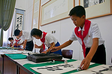 Selected children practicing calligraphy in the Children's Palace, Pyongyang, North Korea, Asia