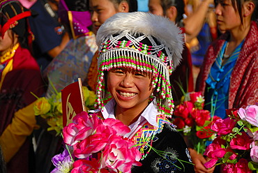 Festival, young Hmong woman, portrait, dressed in traditional clothing, colourful headwear, Xam Neua, Houaphan province, Laos, Southeast Asia, Asia