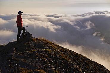 Mountaineer on a summit with fog, Ammergebirge, Ammer Mountains, Garmisch, Bavaria, Germany, Europe