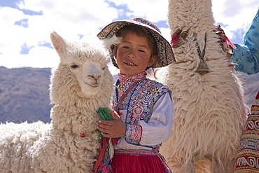 Girl with alpaca, Maca near Colca Canyon, Peru, South America