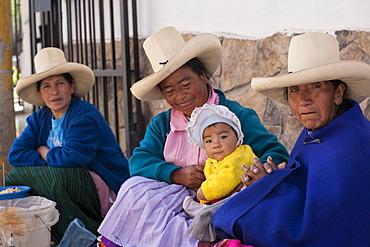 Indigenous street vendors with a child, Baños del Inca, Peru, South America