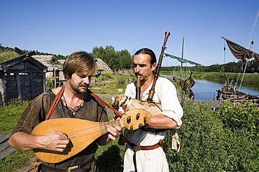 Musicians playing in an amusement park, slavic village, Ukranenland, Torgelow, Mecklenburg-Western Pomerania, Germany, Europe