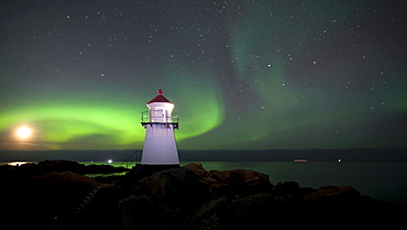 Northern lights, aurora borealis, lighthouse near Hov on the Lofoten Islands, Norway, Europe