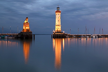 Harbour entrance with the lighthouse and the lion statue in the evening light, Lindau, Bavaria, Germany, Europe, PublicGround