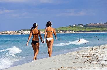 Take a walk on the beach of La Caletta, Sardinia, Italy