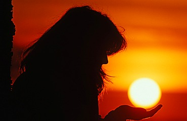 Silhouette of a woman, sunset