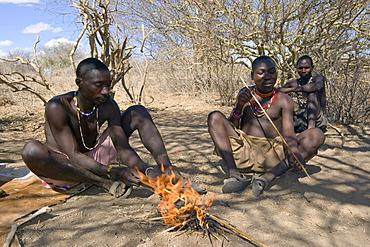 Men of the Hadzabe tribe are making hunting arrows, Lake Eyasi, Tanzania, Africa