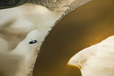 Aerial view, boat on a sand bank at a river bend, Pwani Region, Tanzania, Africa