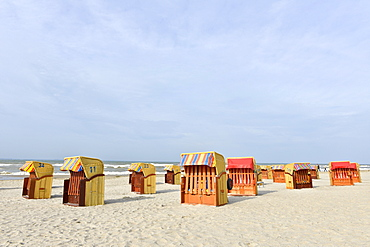 Roofed wicker beach chairs on the beach of Niendorf, Baltic Sea, Schleswig-Holstein, Germany, Europe