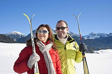 Couple with cross-country skis in the mountains