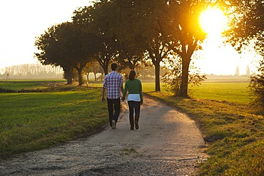 Young couple taking a walk outdoors, in nature