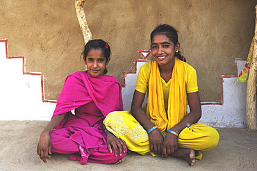 Children sitting in front of a traditional house, Thar Desert, Rajasthan, India, Asia