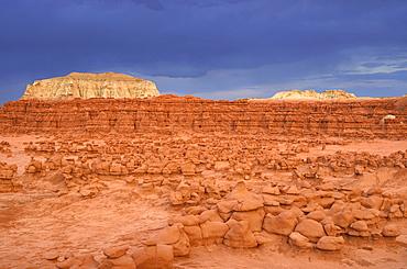 Wild Horse Mesa, thunderstorm, eroded hoodoos and rock formations of Entrada sandstone, Goblins, Goblin Valley State Park, San Rafael Reef Desert, Utah, Southwest, United States
