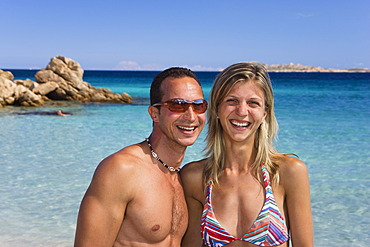 Couple, about 30 years old, on Spiaggia Capriccioli beach, Costa Smeralda coast, Sardinia, Italy, Europe