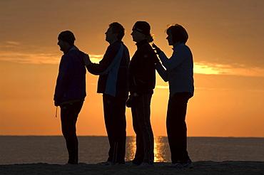 Morning exercises on the beach, S\'Illot, Llevant, Majorca, Balearic Islands, Spain, Europe