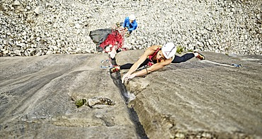 Woman lead climbing a gully, crack in the rock, Martinswand climbing area, Zirl, Tyrol, Austria, Europe