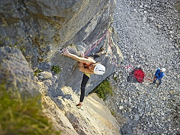 Woman lead climbing a ledge, Martinswand climbing area, Zirl, Tyrol, Austria, Europe