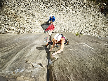 Woman lead climbing a gully, crack in the rock, Martinswand climbing area, Zirl, Tyrol, Austria, Europe
