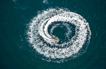 Aerial view, jetski, jetskier performing a circle, off Leucate, Le Barcarès, Languedoc-Roussillon, France, Europe