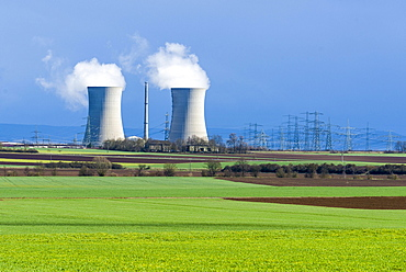 Grafenrheinfeld nuclear power plant, steam coming out of the cooling towers against a dark sky, Grafenrheinfeld, Bavaria, Germany, Europe