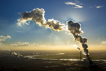 Coal plant Kraftwerk Duisburg-Walsum in front of the Rhine, backlit, cloud of smoke, emissions, Ruhr district, Duisburg, North Rhine-Westphalia, Germany, Europe