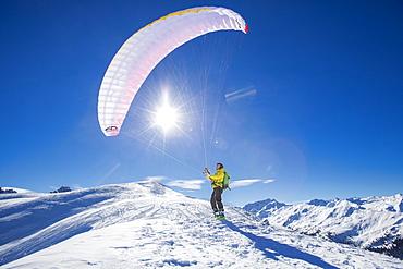 Paraglider, man preparing glider for takeoff, Axamer Lizum, Innsbruck, Tyrol, Austria, Europe