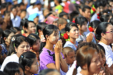 Praying believers in the Azarni Road, Bigboon Festival, day of meditation, pilgrims' procession, Dhammakaya Foundation, Dawei, Tanintharyi Region, Myanmar, Asia