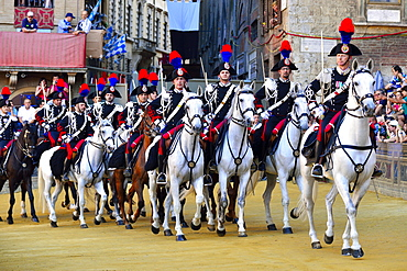 Mounted dragoons at a parade before the historical horse race Palio di Siena, Piazza del Campo, Siena, Tuscany, Italy, Europe