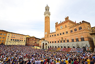 Piazza del Campo with Palazzo Publico on a training day of the Palio di Siena, Siena, Tuscany, Italy, Europe
