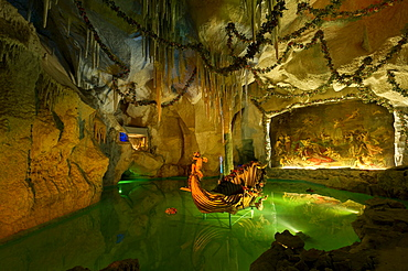 "Venus Grotto of King Ludwig II, artificial stalactite cave with a lake and a shell-shaped boat, painting ""Tannhäuser bei Frau Venus"" by August von Heckel, palace gardens of Linderhof Palace, Upper Bavaria, Bavaria, Germany, Europe"