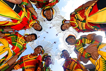 Nagaland tribesmen looking down with heads in a circle, Kisima Nagaland Hornbill festival, Kohima, Nagaland, India, Asia