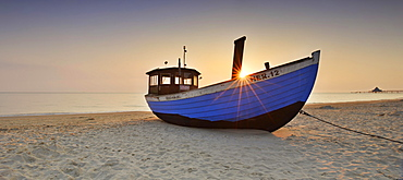 Fishing boat on beach at sunrise, Heringsdorf, Usedom, Mecklenburg-Western Pomerania, Germany, Europe