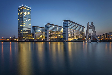 Treptowers and Molecule Men monument in the river Spree during blue hour, Berlin-Treptow, Berlin, Germany, Europe