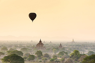 Hot air balloon over Bagan temples at sunrise, Bagan, Division Mandalay, Myanmar, Asia