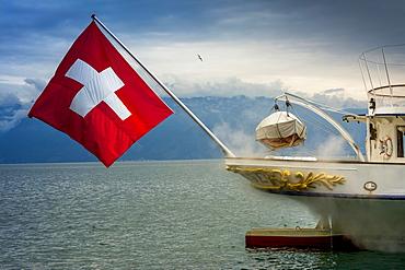 La Suisse paddle steamer on Lake Geneva with Swiss flag, Canton of Vaud, Switzerland, Europe