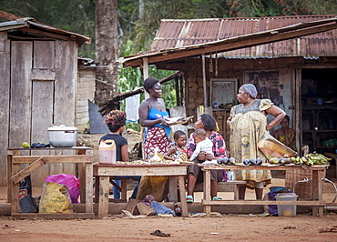 Street scene, woman at a food stall, village near the town of Campo, Southern Region, Cameroon, Africa