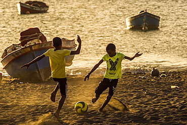 Teenager playing soccer, children, city beach of Tarrafal, São Nicolau, Cape Verde, Africa
