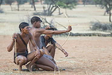 Kung Bushmen with bow and arrow, Zebra Lodge, Hardap Region, Namibia, Africa