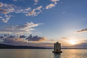 Spanish Windmill in lagoon, sunset, Orbetello, Tuscany, Italy, Europe