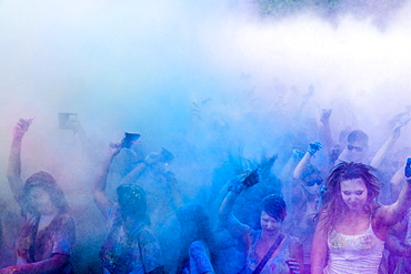 Thousands of young women and man are throwing color powder in the air at the colorful Holi festival, Dresden, Saxony, Germany, Europe
