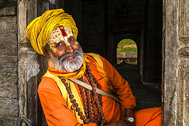 Portait of a Sadhu, holy man, sitting at a shrine at Pashupatinath temple, Kathmandu, Kathmandu District, Nepal, Asia